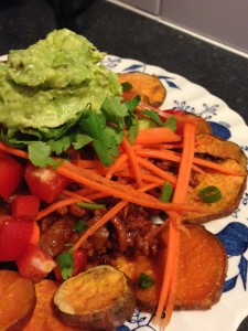 A tower of sweet potato nachos crowned by delicious guacamole