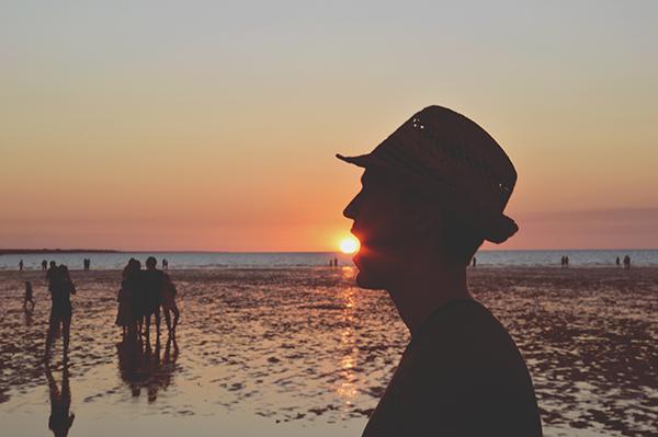 Michael eating sun at Mindil Beach
